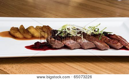 Grilled meat with cranberry sauce