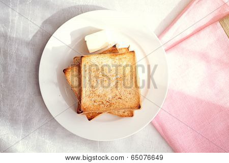 Toasted bread slices with butter pat for breakfast