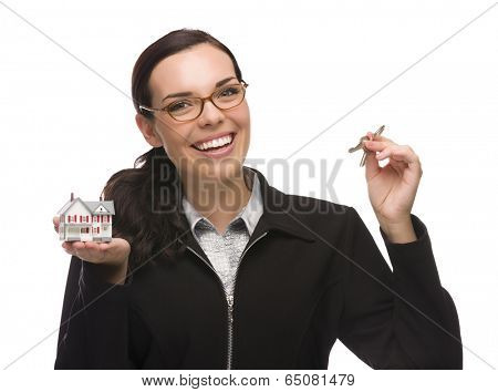 Mixed Race Female Presenting House Keys Holding a Small House Isolated on White Background.
