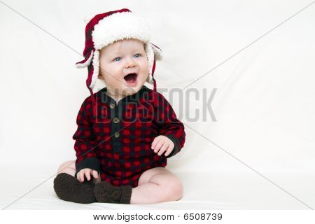 Christmas Baby With Red Plaid Shirt And Furry Wool Hat, Mouth Open