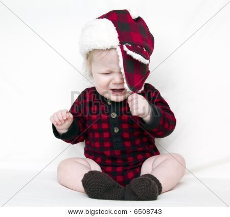 Crying Christmas Baby Trying To Pull Off Fuzzy Hat
