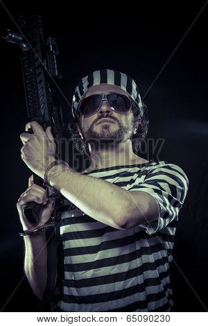 riot, prisoner in a prison with a machine gun