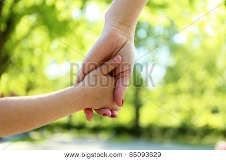 Mom and daughter hands, outdoors