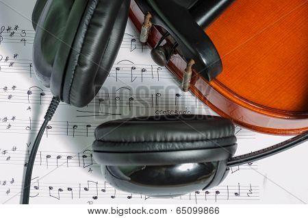Black Headphones On A Classical Wooden Violin