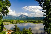 pic of bavarian alps  - panorama landscape in Bavaria with alps mountains and lake Hopfensee nearby city Fuessen - JPG