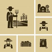 stock photo of silos  - Farmer man - JPG