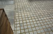 foto of planters  - Granite pavement as a background and wooden planter lines - JPG