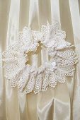 image of garter  - White garter bride closeup - JPG