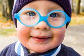 foto of squinting  - Of Caucasian boy with poor eyesight  - JPG
