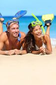 foto of fin  - Beach couple having fun snorkeling on vacation - JPG