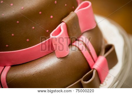 Delicious chocolate cake with pink bow decoration