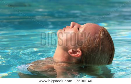 Portrait Of Woman Relaxing In Swimming Pool