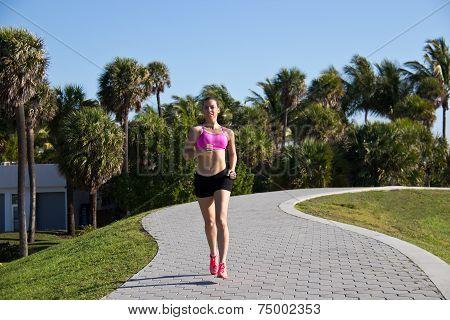 Hispanic Woman Jogging In A Tropical Setting