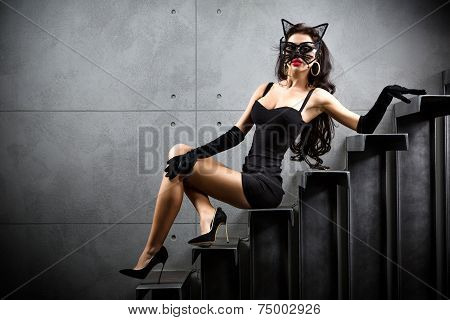 Sexy Woman In Cat Suit Lying On Stairs