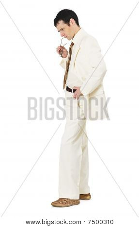 Thoughtful Man In White Business Suit