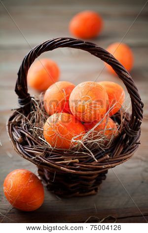 Bright orange easter eggs with selective focus