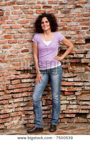 Redhead Lady Near Grunge Wall
