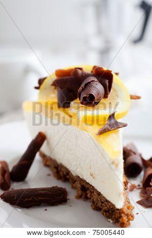 Lemon cheesecake with lemon slice and chocolate curls