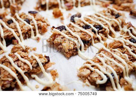 Homemade granola bars with fresh muesli and raisins