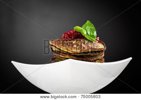 Healthy and delicious spinach pancakes with lingonberry jelly