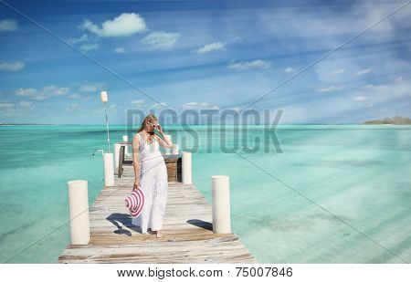 Girl in the white dress on the wooden jetty, Great Exuma, Bahamas