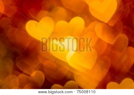 photo of red and golden hearts boke as background
