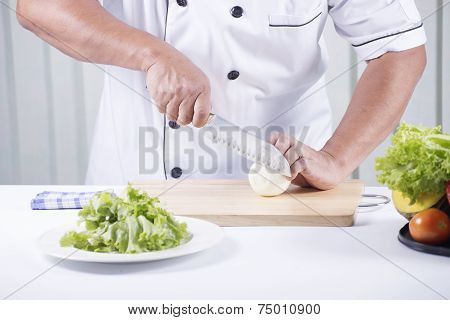 Chef Cutting The Onion