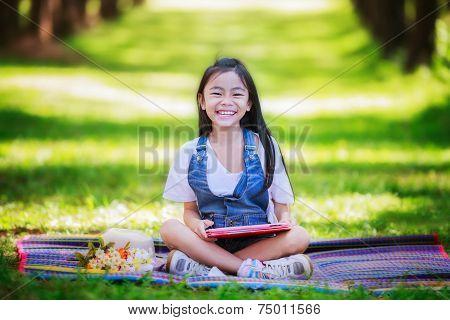 Funny Little Asian Girl Learning