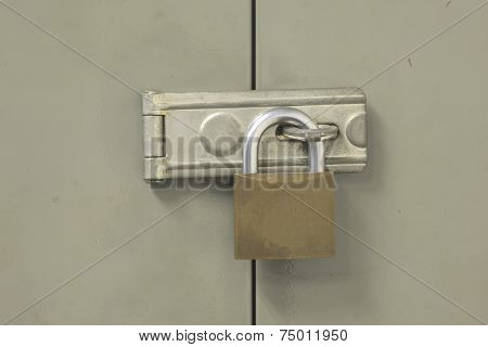 Locked cabinet door closeup background