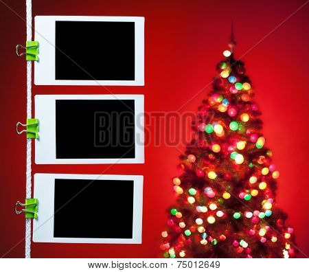 blank photos hanging on rope, christmas tree background