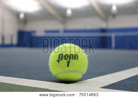 Penn tennis ball at indoor court
