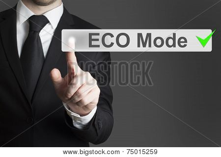 Businessman Pushing Touch Screen Button Eco Mode