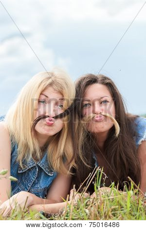 Blonde And Brunette Girls Are Grimacing