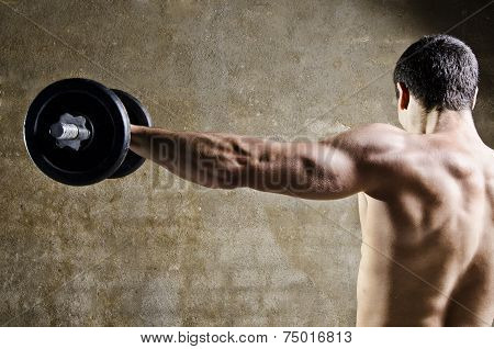 Man Lifting Weights With Shoulders Training