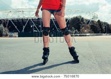 Woman Rollerblading Outside Stadium