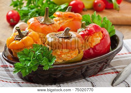 Stuffed peppers minced chicken with carrots with tomato sauce