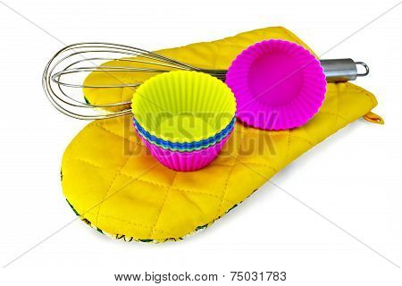 Molds for cupcakes with mixer on yellow potholder