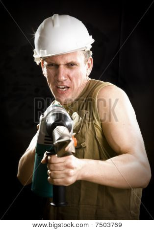 The Builder In A Protective Helmet