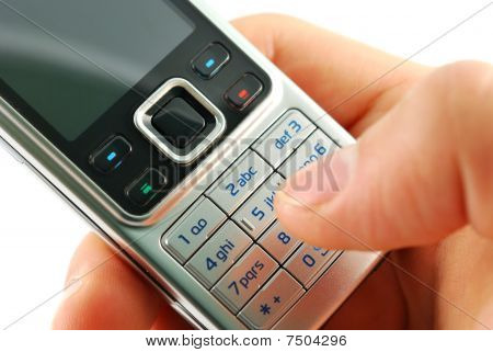 Dialing a mobile phone closeup
