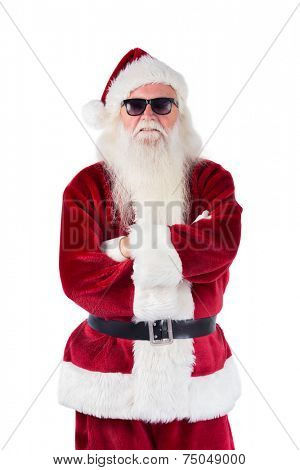 Santa Claus wears black sunglasses on white background an folded arms