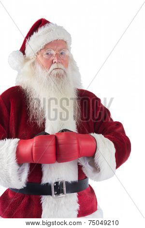 Santa Claus wears boxing gloves on white background