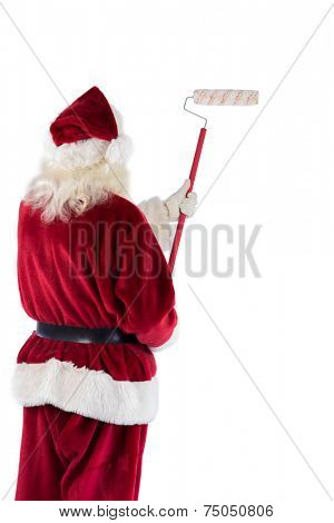 Father Christmas paints a wall away from camera