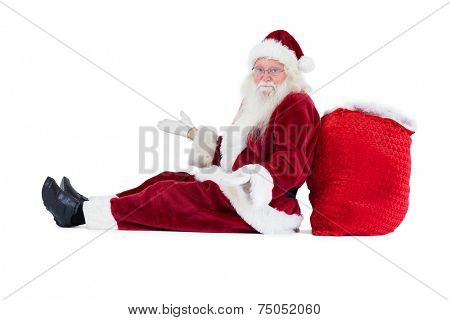 Santa sits leaned on his bag and has no clue on white background