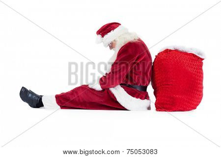 Santa sits leaned on his bag on white background and sleeps