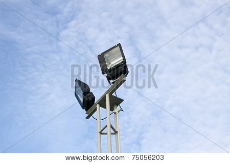 Light Poles With A Blue Sky And Clouds