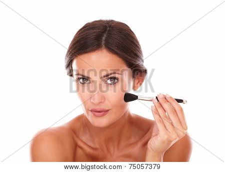 Pretty Latin Female Applying Facial Care Product