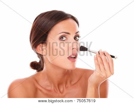 Hispanic Female Applying Blush On Her Face