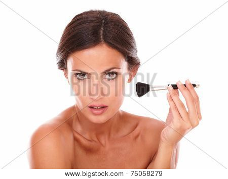 Beautiful Woman Applying Blush On Her Face