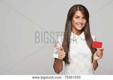 Woman showing red card in hand