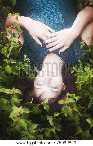 Portrait of girl lying on grass
